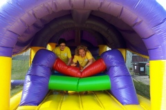 Volunteers-Margaret-Michelle-testing-out-the-Bouncy-Castle.